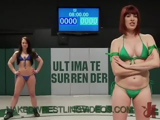 Babes wrestle and strapon fuck on mats