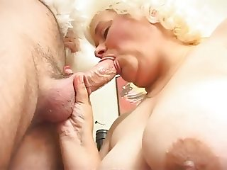 chubby blonde mature eating santa claus
