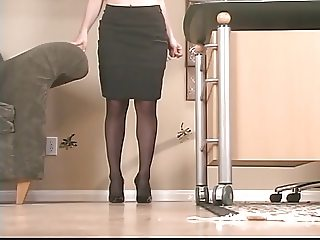 Sexy brunette with glasses and stockings spreads and toys her pussy with a dildo