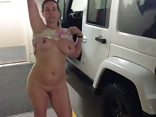 Pretty girl naked in parking garage