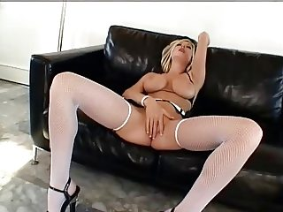 British slut Michelle B in a DP scene in white fishnets