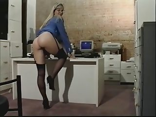 Blonde female secretary fucks with dildo on desk