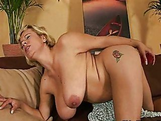 Mature soccer mom with big tits is toying