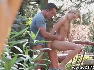 petite blonde gives footjob in the garden