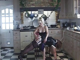 Rubber Angelica lap spanked in the kitchen by Madame C