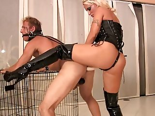Mistress Holly fucks him