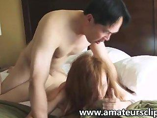 Cute amateur redhead fucks an asian