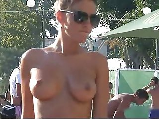 Girl with perfect boobs topless on the beach