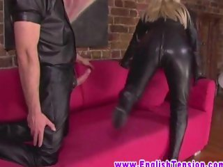 BDSM british MILF in leather outfit makes sub to bang her