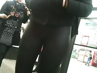 Nice ass at bus stops in shiny leggings