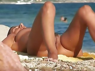 French brunette milf nudist at beach