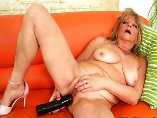 Grandma with big tits fucks big black dildo