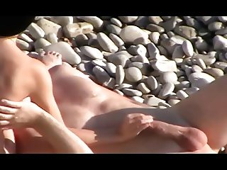 Voyeur on public beach. Handjob and Blowjob