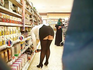 sexy bitch flashing her cunt and stockings in public