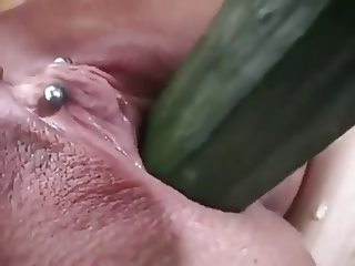 mature pussy inserts cucumber and squirts