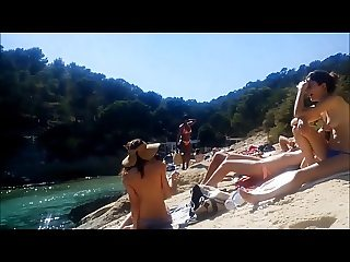 mallorca. young spanish topless teens on the beach