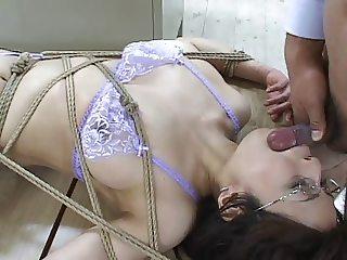 Teacher tied down to a desk