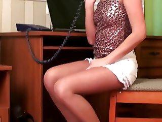 Masturbating under her tan pantyhose