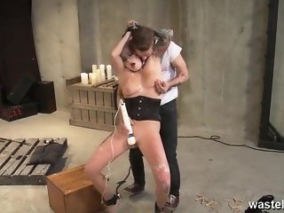 Purple haired female submissive is chained up