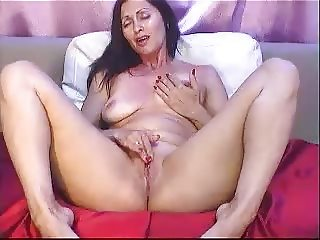 mature woman rubbing clit