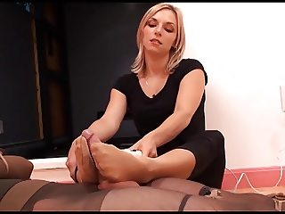 Mistress in shiny pantyhose gives amazing footjob