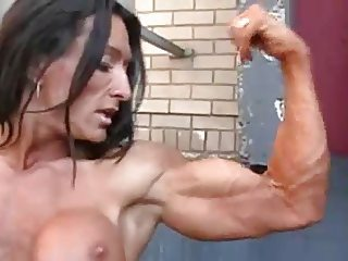 Steel slut Raby posing and fingering in the alley