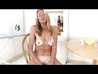 Blonde mature fucks herself with a banana