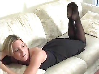 Sexy black pantyhose feet tease