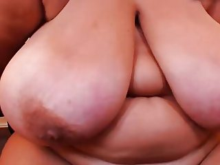 Huge hanging tits on older lady