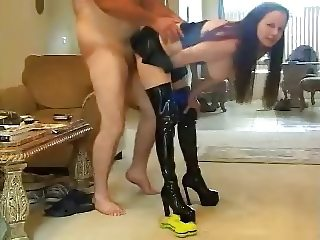 milf in leather fucks with cumshot