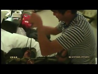 Foot torture and hogtied bondage on Chinese girl