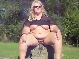 Fat blonde chick pissing