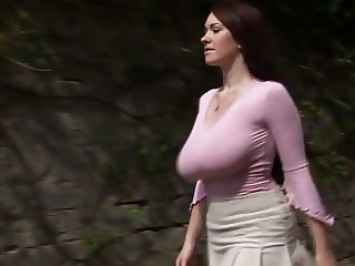 Busty girl walking, no bra, jiggling