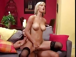 Blonde with black stockings fucks on red sofa