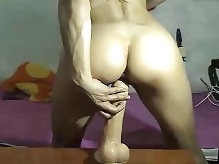 Brunette fingers and fucks her pussy and ass with toy also