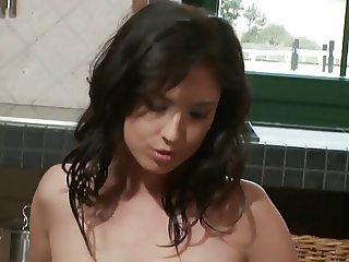 Brunette whore masturbates in the kitchen with a thick dildo