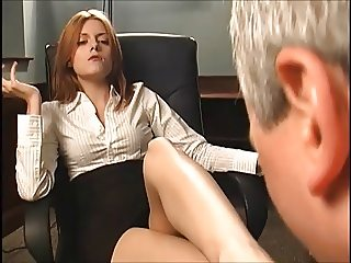 Redhead boss makes him suck her feet