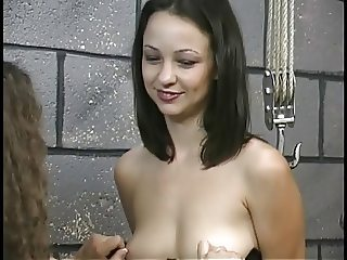 Chick in lingerie punishes sexy brunette in dungeon