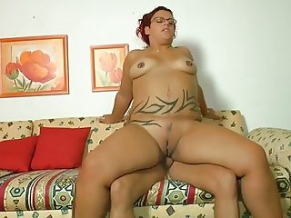 Tattooed plump girl banged on the couch