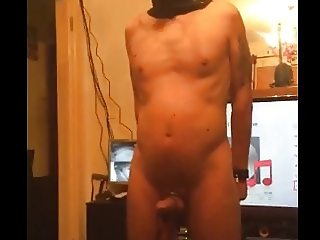male slave chained to pole made to cum