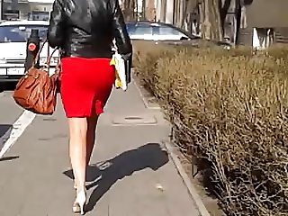 Candid #243 Woman with nice legs in red skirt and high heels