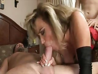 Beautiful Horny Milf in Red Corset Fucking two Boys