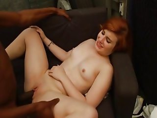 Hot-ass redhead enjoys a screw from a BBC