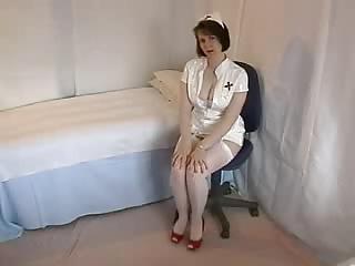 Nurse with nice gams flases her panties.
