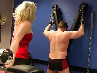 Caning punishment by blonde mistress
