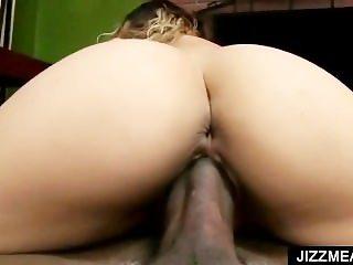 Nympho slut rides black penis in close-up