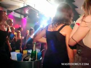 Sexy sluts sharing loaded dick in gangbang at an orgy