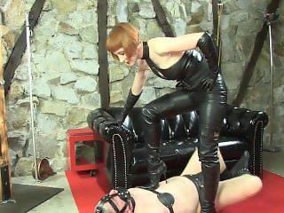 Leather mistress torturing slave