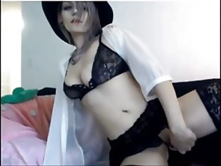 Cam girl in black lace and purple hair