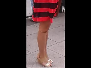 Girl with sexy legs in nylon socks and wedges